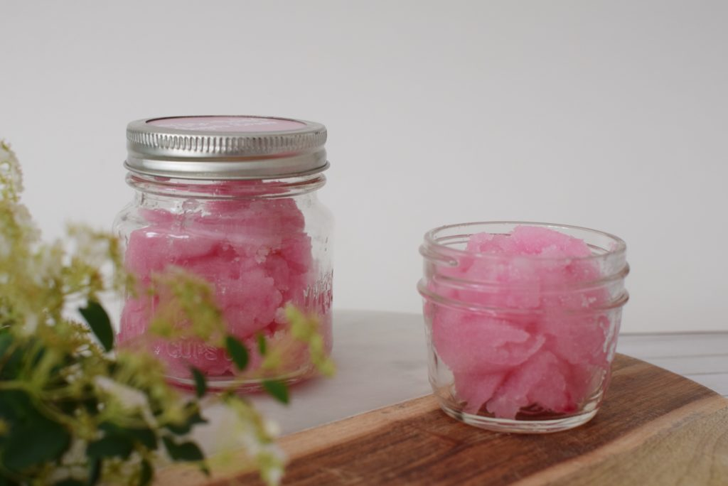 Super easy DIY rose water sugar scrub that would make a perfect valentines gift, hostess gift, heck just for yourself too! Click to get the instructions on how to make this in 5 minutes!